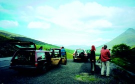 The convoy of cars reaches the Quirang summit on the Isle of Skye.