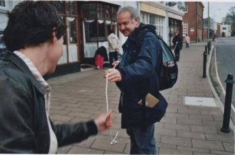 Phil Smith (right) and walker on a walk/performance in Sidmouth.