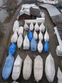 Boats wrapped for winter seen from the bridge over to the studio on 1st December 2011