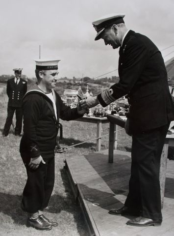 John receiving a trophy for marksmanship