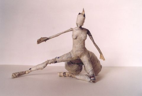 Paper figure with extended buttocks