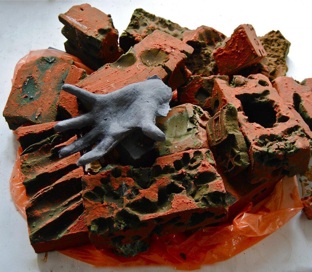 Hand and Bricks