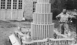 Image of the artist and his model of the 'Encyclopedic Palace'