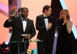 Steve McQueen collects the Best Picture award