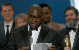 Steve McQueen and team accept the Oscar for Best Picture