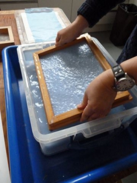 Forming the paper in the mould & deckle