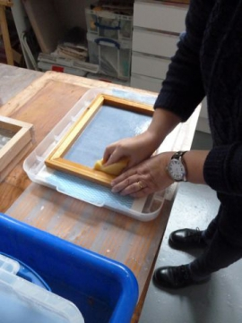 Releasing the paper from the deckle