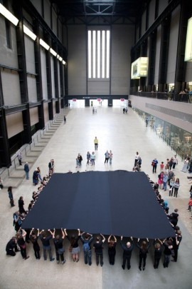 Liberate Tate campaigners unveil a huge version of Malevich's iconic Black Square in Tate Modern's Turbine Hall, in protest at BP sponsorship. Photo: Martin LeSanto-Smith