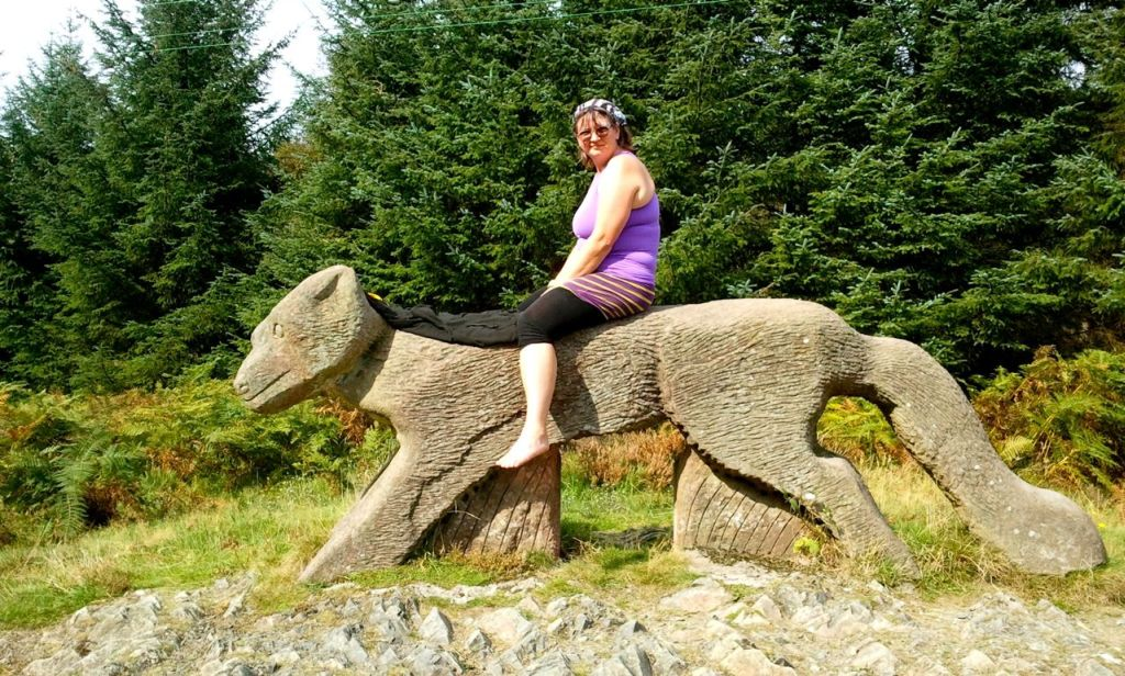 sculpture of fox from red sandstone