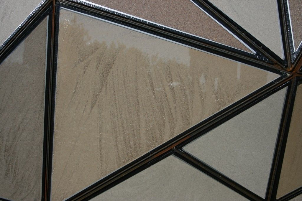 detail of the patterns made when pouring in the sand to the double glazing unit