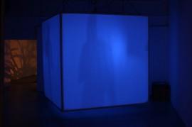 blue object in darkened space