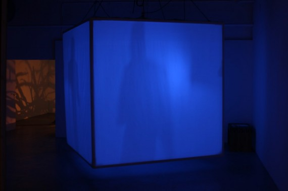 blue object in darkened space