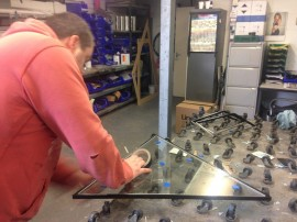 The guys at work..they use a special table with loads of wheels on to allow the glass to be moved around easily and not damaged