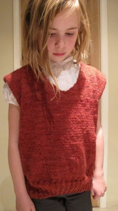 Wartime knitting: my 9 year old daughter in the adult 'Up-and-Over' pullover I completed March 2015