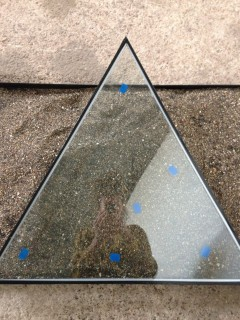 finally...the dried sieved sand...i placed one of the triangles over the top to give an idea of the reflections that will be seen