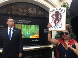 Protestor outside Sotheby's, London. Photo: Shiri Shalmy