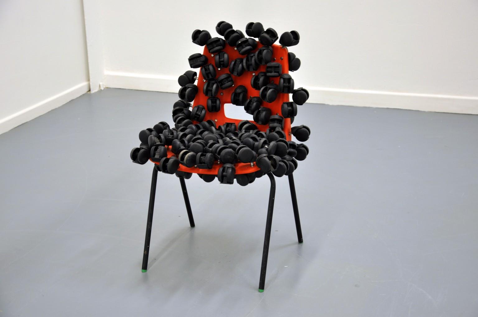 Untitled (Castors & Chair), 2012. Sikander Pervez. Sculpture, Red School Chair, School Chair, Chair, Castor Wheels, Wheels, Castors, New Art West Midlands 2014