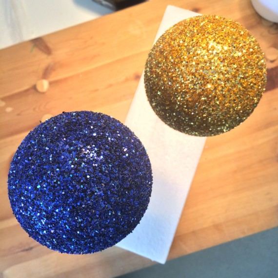 Work in progress on a maquette for a new piece.  Blue and gold glitter globes.