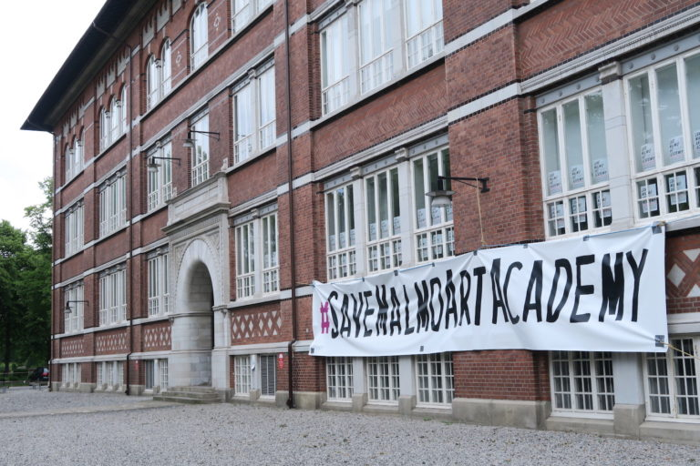 The exterior of the Malmö Art Academy with a banner