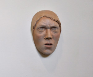 Beth Collar, Untitled (furrowed brow), Lime wood, MAC cosmetics, roughly face sized installed at the Freud Museum as part of Tall Tales touring exhibition