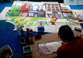 Connected Communities festival 2015. Artist Patrick Amber paints Castlegate, Sheffield.