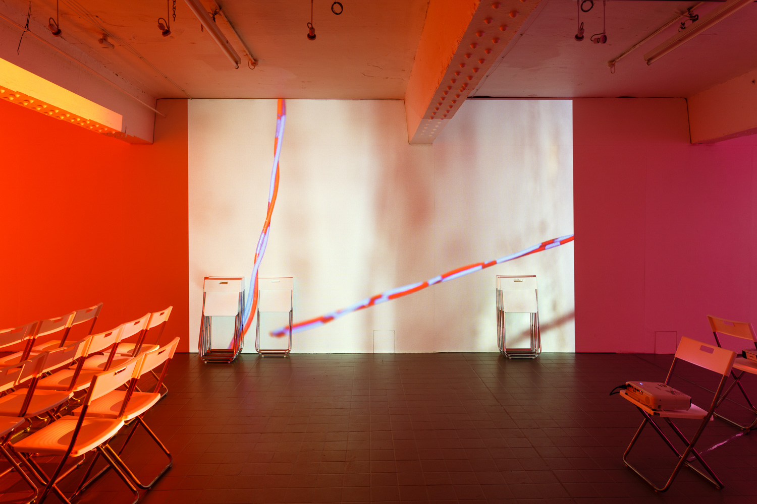 Holly Rowan Hesson, Assembly, 2016, projection (looped series of 147 stills for each of three projectors), chairs, dimensions variable (photo Jules Lister) http://www.hollyrowanhesson.co.uk