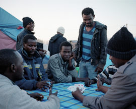 Daniel Castro Garcia, Calais, France, November 2015 Sudanese men playing cards, 2016. Courtesy: artist and BJP International Photography Award 2017.