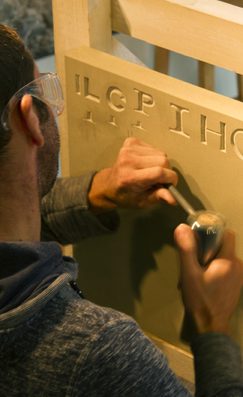 Cutting lettering in stone