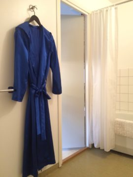 Mr Dandy Blue's robe hangs in the bathroom.  I wore the robe for The Artistic Researcher's 'Hothousing' events at Supermarket Art Fair, Stockholm 2017.  'Following Eugène #4: intimate landscapes' invited visitors to make companion monoprints of our bodies.