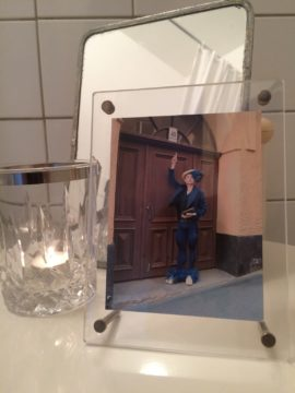 A framed photograph from 'Following Eugène #2: An evening's walk', 2015, sits on the bathroom table.   The character Mr Dandy Blue lead guided walks through Eugène Jansson's Södermalm, Stockholm.  Costume produced by Tim Mårtenson to my design.