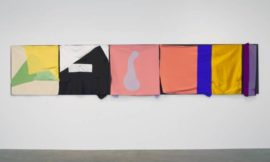 "Richard Tuttle, The Critical Edge III, 2015 fabric, wood, nails, hand-sewn brown thread; five black MDF panels and five fabric elements 39-1/8"" x 15' 1/2"" x 6-3/4"" (99.4 cm x 458.5 cm x 17.1 cm) © Richard Tuttle, courtesy The Pace Gallery"