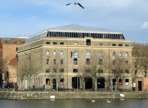 Arnolfini, Bristol. Photo: Adrian Pingstone via Wikipedia (https://en.wikipedia.org/wiki/Arnolfini#/media/File:Arnolfini_from_across_the_harbour_arp.jpg)