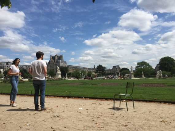 Two actors rehearsing in the Le Jardin des Tuileries, using the chair as a prop. May 2017