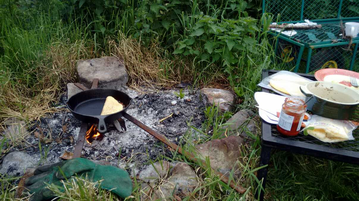 cooking dinner on an open fire