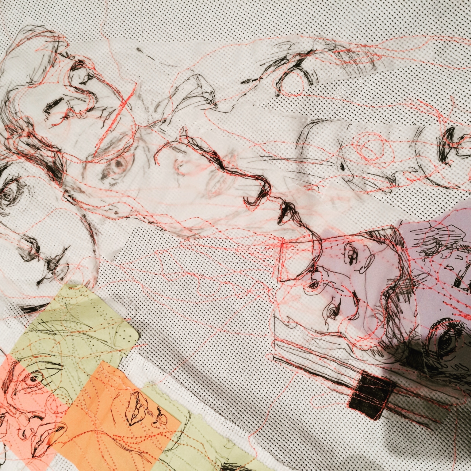 Detail from the contributed portraits of participants, stitched to create a £D sculptural heart.