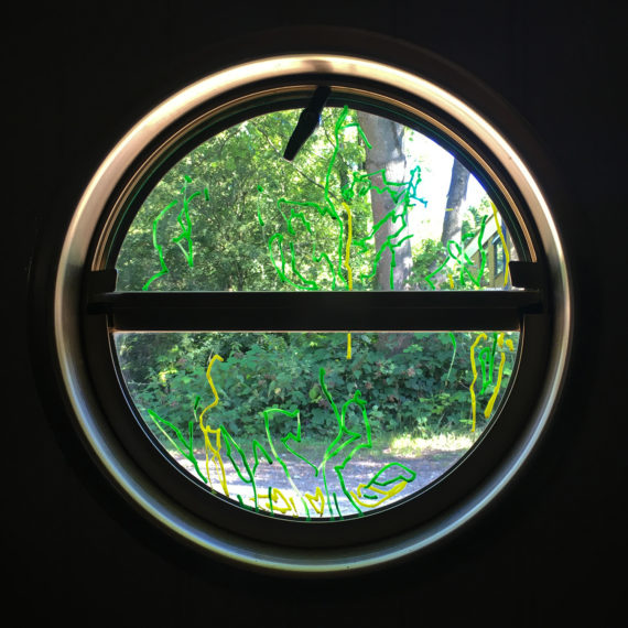 Porthole - I am the media - Tuesday 18th July 2017 Rickmansworth - Grand Union Canal - chalk marker pen on glass - Hayley Harrison