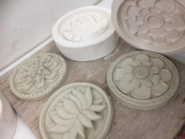 Turning casts out of moulds