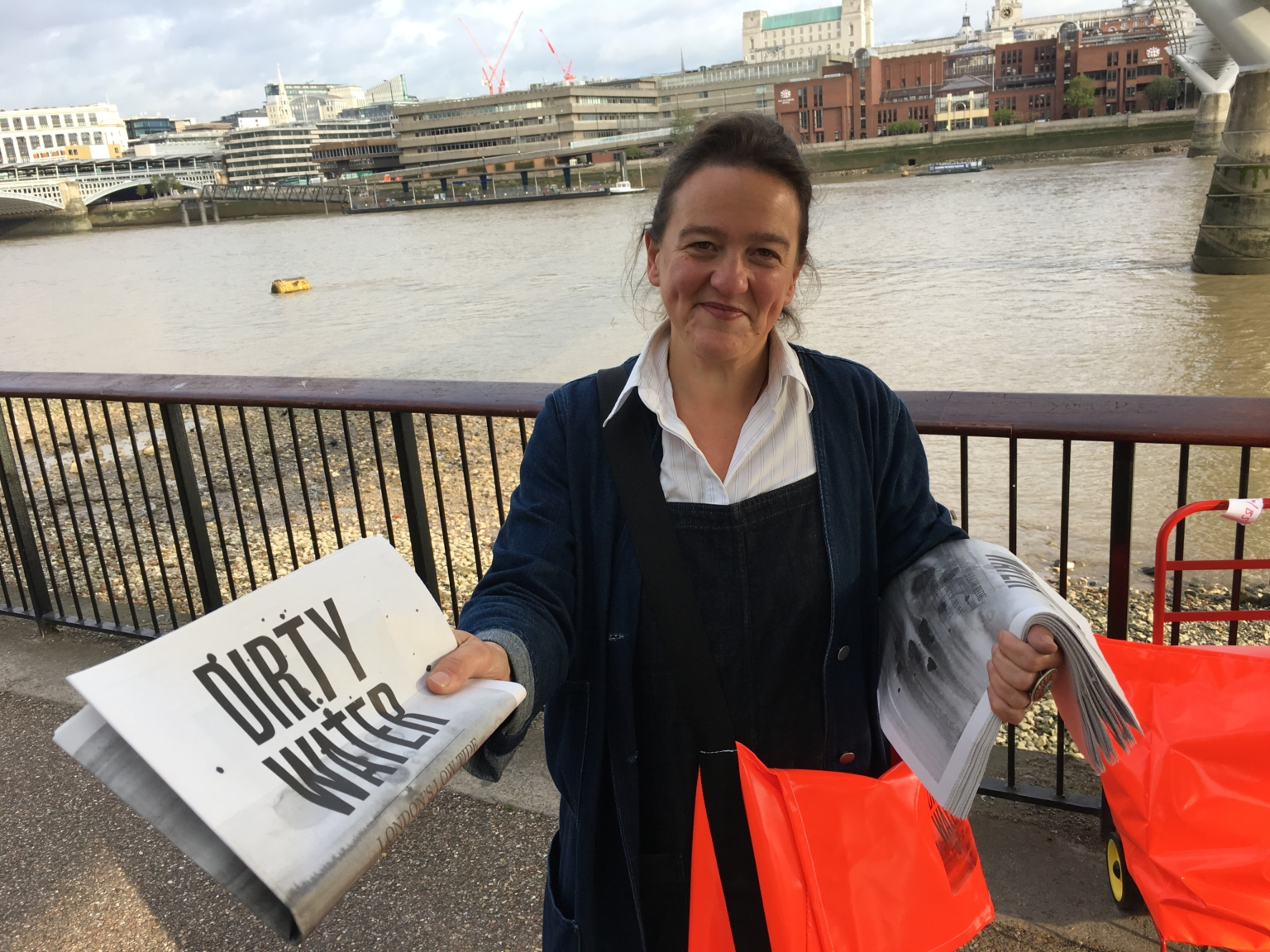 Tania Kovats hands out copies of her work Dirty Water