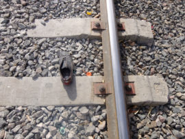 Research image of clothing on train tracks.