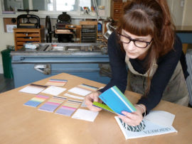 Angie Butler in her studio, selecting printing materials for the book from Bristol-based paper supplier Arboreta Papers