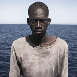 César Dezfuli, portrait of Amadou Sumaila, migrant rescued in the Mediterranean Sea off the Libyan coast, winner of the Tenth Anniversary Taylor Wessing Photographic Portrait Prize 2017. © César Dezfuli