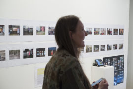 Photo of me and my work displayed just behind