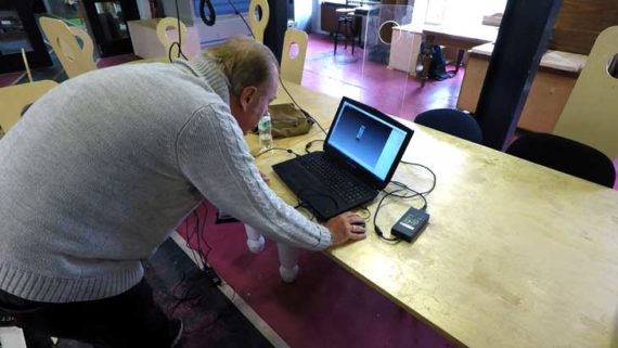 man at computer editting 3d scan information