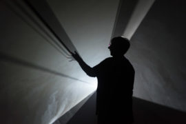 Photo by Darren O'Brien/Guzelian Picture shows A visitor looks at Doubling Back, 2003 by Anthony McCall, The Hepworth Wakefield, Wakefield.  The exhibition Anthony McCall: Solid Light Works opens 16 Feb - 3 June 2018 at The Hepworth WakefIeld.  Picture taken 14/02/2018