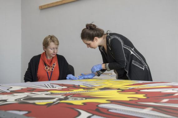 Conservation science researcher Angelica Bartoletti (right) and paintings conservator Rachel Barker during the cleaning treatment of Whaam!. Photo: © Tate (Matt Greenwood).