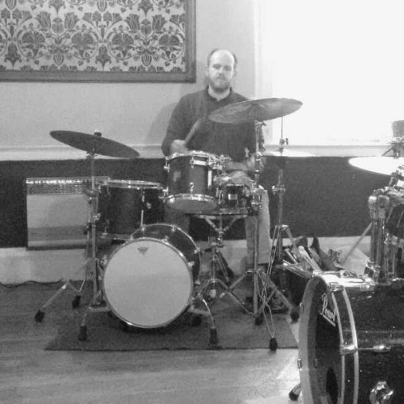 drum kit with man behind it