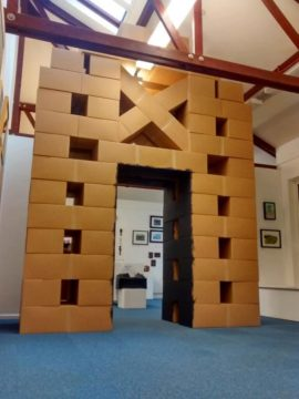 Cardboard boxes creating an arch to resemble the 'church' structure inside the rhondda tunnel.