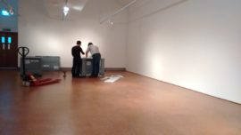 two people in near empty gallery space