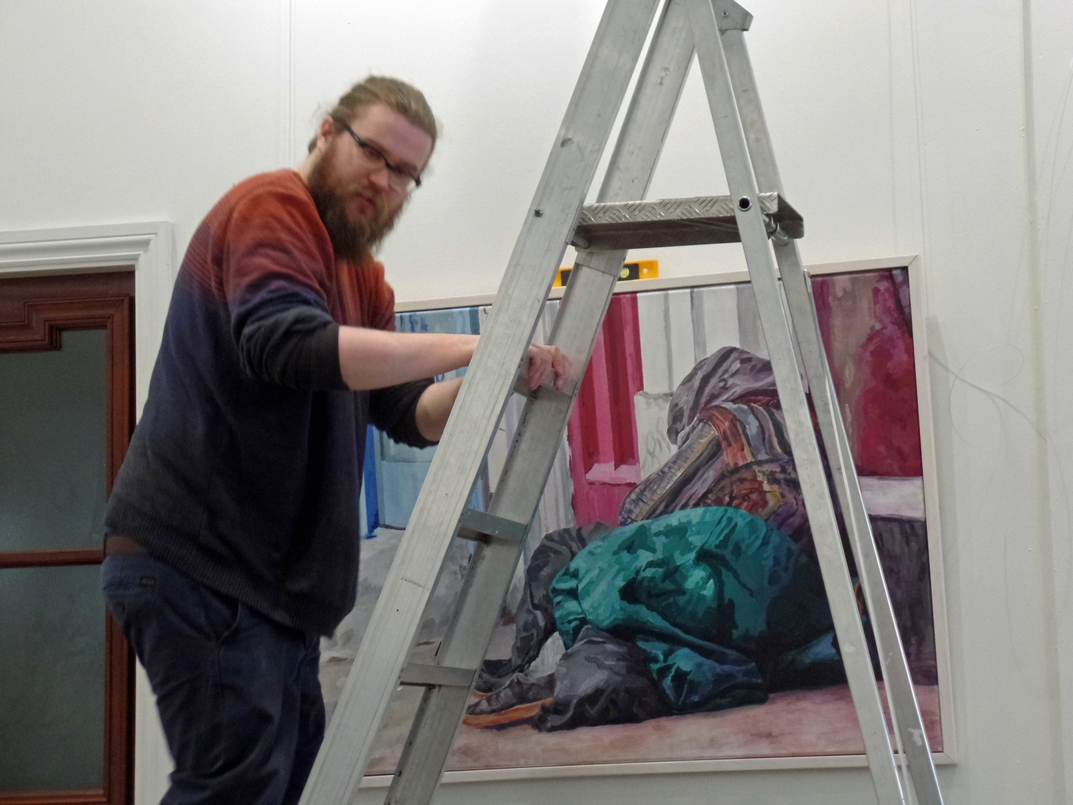 Adam helping to hang the underlined project exhibition 2018