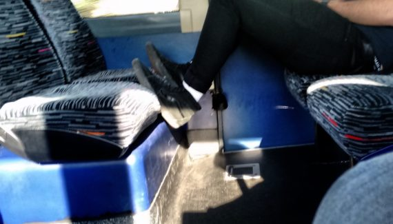 feet on a bus seat